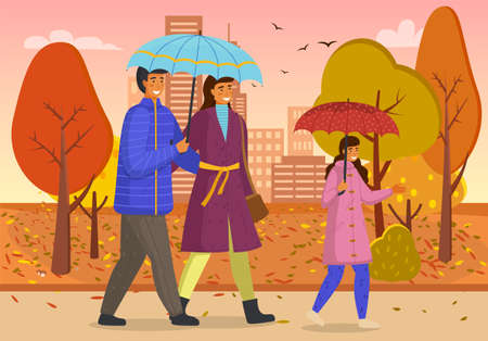 Family walks in fall city park. Girl in pink raincoat carries red umbrella. Parents under blue umbrella. City autumn park, rain, yellow trees. Be happy with your family when bad weather. Autumn time