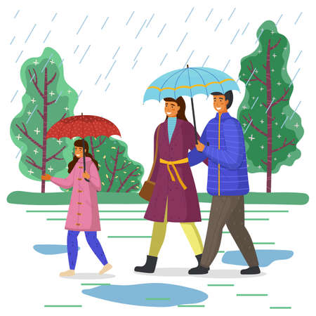 The family walks while raining. Girl in pink raincoat carries red umbrella. Parents under blue umbrella. City autumn park, puddles, rain. Be happy with your family even in bad weather. Autumn time