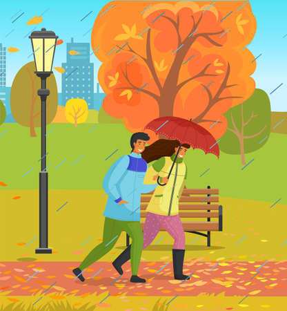 Autumn park, couple of happy girl and guy with umbrella walking in urban park under rain with city buildings at background, autumn trees, young adult people walking though wind, rainy weather