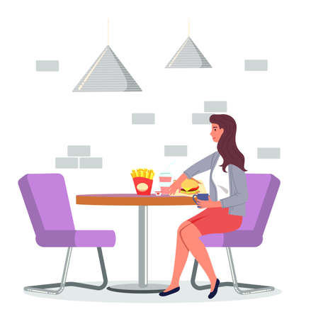 Young woman sitting at table in cafe and eating french fries, burger, drinking tea or coffee. Lady wearing cardigan and skirt relaxing at soft chair in restaurant. Woman eating unhealthy fat food