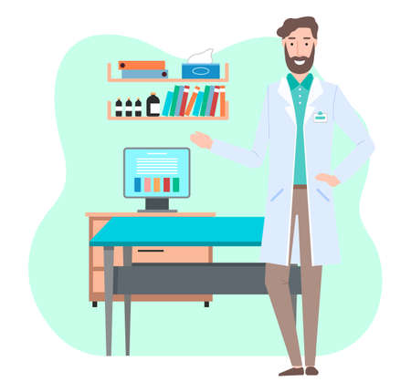 Young bearded friendly doctor or vet is standing and showing a screen on a computer monitor. Man in white medical gown in doctor s office near the examination table. Shelves with professional items