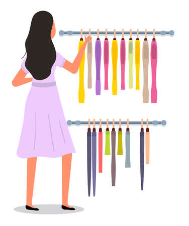The girl is choosing colored garment on hangers. The young fashion woman in dress isolated on white background. Buyer is selecting clothes in a store. Shopper during the sale. Rack with clothing items Stock Illustratie