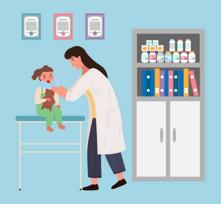 Doctor examines child in hospital. Baby sits with a teddy bear. Pediatrician examines the patient s oral cavity. Little female character at appointment with doctor. Physician works at clinic