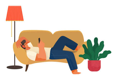 The man lies on the couch at home and correspondence surfing the Internet. Male character communicating through network on the smartphone. Social media network communication digital gadget addiction