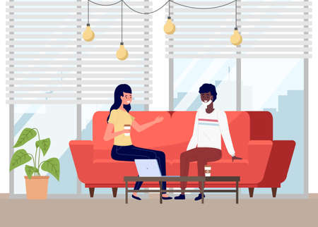 People are sitting on the couch and communicating. A girl and a man in protective medical face mask talking during quarantine. Friends or colleagues at a meeting in a cozy bright room, safe contact