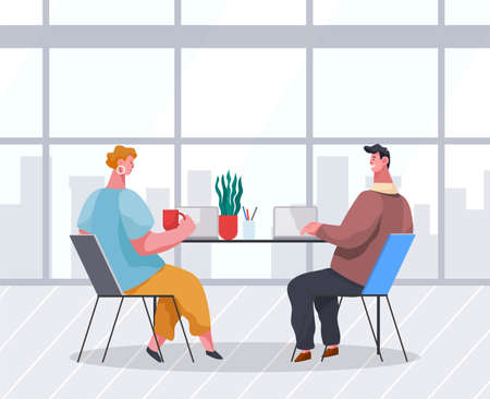 Businessmen dressed in formal clothes are sitting at the table with laptops and talking. Office workers discussing matters. Business meeting and consideration of working issues. Friendly team work