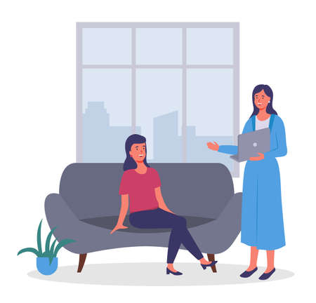 Businesswomen dressed in formal clothes sitting on the sofa, standing with computer in room and talking. Office meeting and consideration of working affairs. Office workers women in workspace