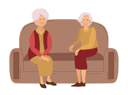 Two grandmothers on a meeting at home sitting on the sofa communicating, isolated on white. Friendship of old people. Old Girlfriends. Older woman talking together. Old women discuss retirement