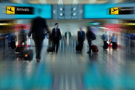 lounge: Business People at the Airport Moving with Blur Editorial
