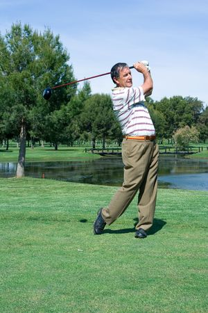 A Middle Aged Golfer at the Tee Stock Photo - 4807077