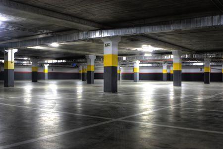A Big Empty yellow Underground Parking Garage Redactioneel