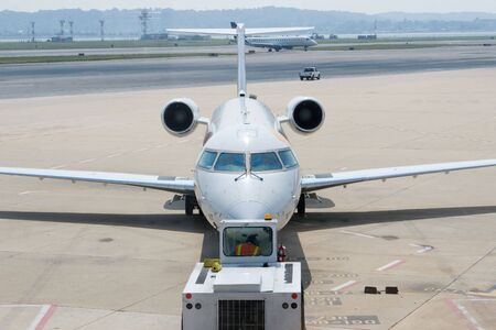 An Airplane Departing the Gate and Ready to Takeoff Stock Photo - 5491557