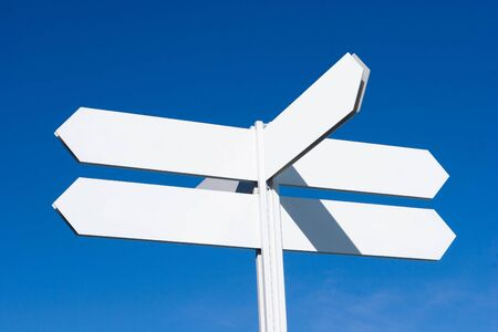 A Blank Directional Sign Post with Blue Sky photo