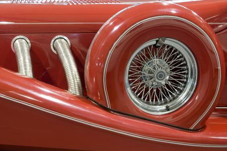 Closeup of Exhaust Pipe and Spare Tire on an Antique Car photo