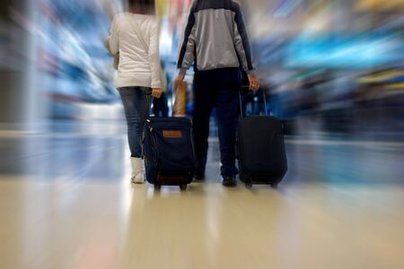 A Couple walking in the airport terminal photo