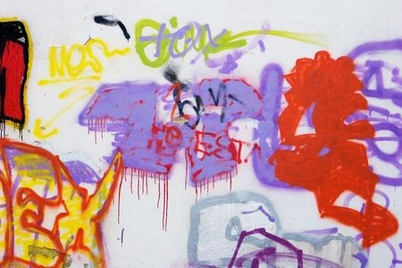 slums: A messy ghetto abstract graffiti wall background Stock Photo