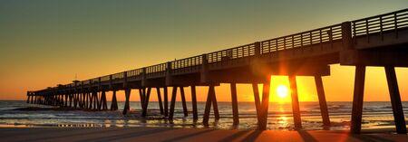 aura sun: Fishing Pier at Sunrise Stock Photo