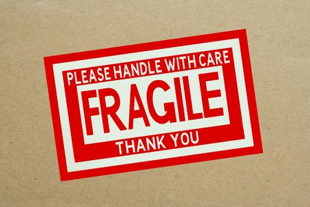 Fragile Handle with Care Sticker on Shipping Box photo