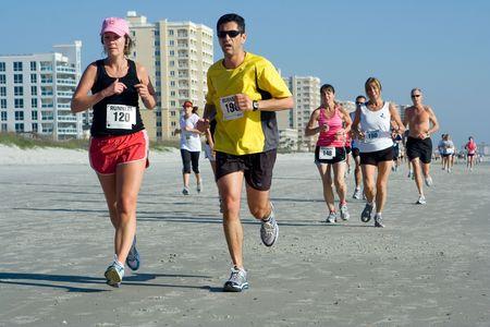 Jacksonville Beach, Florida, USA - February 8, 2009: Runners compete in the Jacksonville Beach 10 mile beach run. Stock Photo - 6884758
