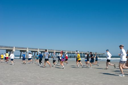 JACKSONVILLE BEACH, FLORIDA - FEBRUARY 14: Runners compete in the 10 and 5 mile John Tenbroeck Memorial Winter Beach Run on February 14, 2010 in Jacksonville Beach, Florida.