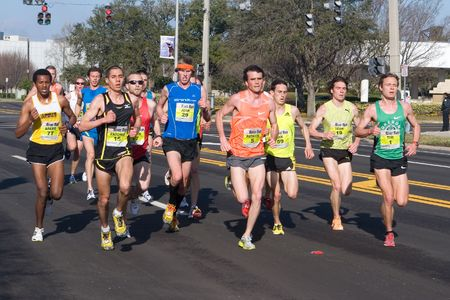 kilometer: JACKSONVILLE, FLORIDA - MARCH 13: Runners compete in the 33rd Annual 15 Kilometer Gate River Run, the largest 15k in the USA, on March 13, 2010 in Jacksonville, Florida.