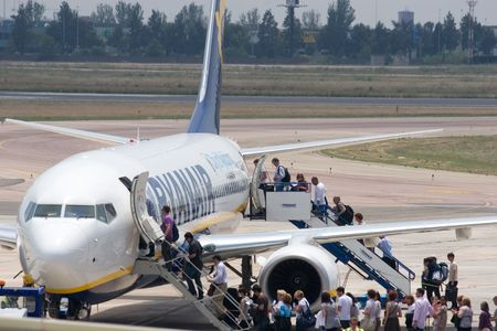 valencia: VALENCIA, SPAIN - JUNE 3: Ryanair, an Irish airline,  will charge 20 euros ($24.40) each way for the first checked bag in July and August, up from 15 euros ($18.30) during other times of the year.  A Ryanair Aircraft on June 3, 2010 in Valencia, Spain.
