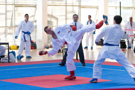 VALENCIA, SPAIN - JUNE 12: Contestants participating in the Karate Competition of the 2010 European Police and Fire Games (EUROPOLYB) in Valencia, Spain on June 12, 2010.
