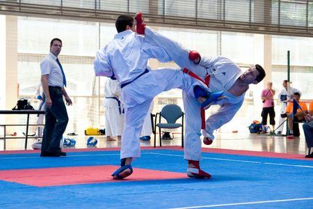 karate kick: VALENCIA, SPAIN - JUNE 12: Contestants participating in the Karate Competition of the 2010 European Police and Fire Games (EUROPOLYB) in Valencia, Spain on June 12, 2010.  Editorial