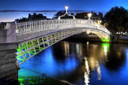 ireland: The hapenny bridge in Dublin, Ireland, at night