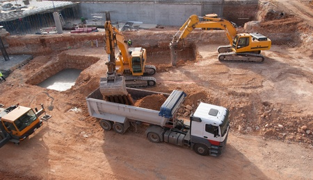 Construction site with bull dozer and dump truck photo