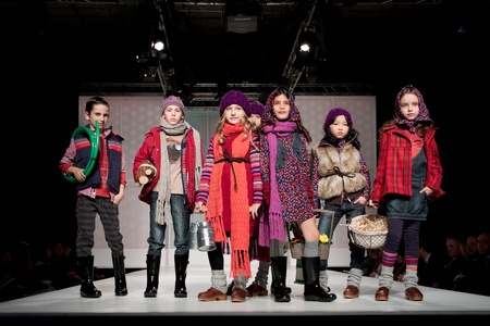 children's show: VALENCIA, SPAIN - JANUARY 21: Unknown child models at the FIMI Childrens Winter Fashion Show with the designer Boboli on the runway in the Feria Valencia on January 21, 2011 in Valencia, Spain. Editorial