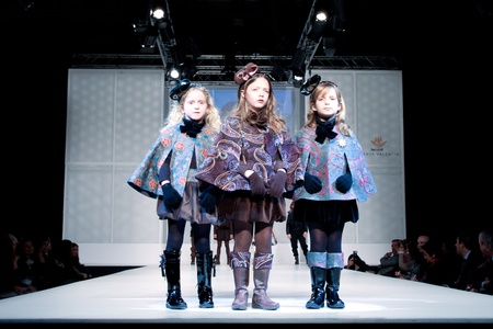 lea: VALENCIA, SPAIN - JANUARY 21: Unknown child models at the FIMI Childrens Winter Fashion Show with the designer Lea Lelo on the runway in the Feria Valencia on January 21, 2011 in Valencia, Spain.