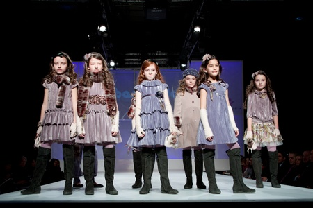 VALENCIA, SPAIN - JANUARY 21: Unknown child models at the FIMI Children's Winter Fashion Show with the designer Barcarola on the runway in the Feria Valencia on January 21, 2011 in Valencia, Spain. Stock Photo - 8644787