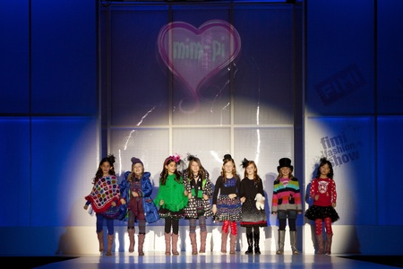 VALENCIA, SPAIN - JANUARY 21: Unknown child models at the FIMI Childrens Winter Fashion Show with the designer Mim-Pi on the runway in the Feria Valencia on January 21, 2011 in Valencia, Spain.