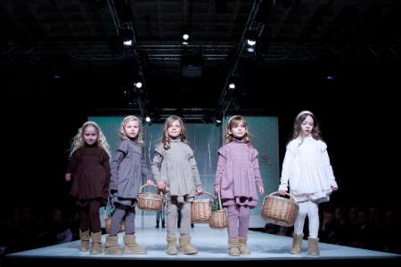 VALENCIA, SPAIN - JANUARY 21: Unknown child models at the FIMI Childrens Winter Fashion Show with the designer Loran Jinha on the runway in the Feria Valencia on January 21, 2011 in Valencia, Spain.