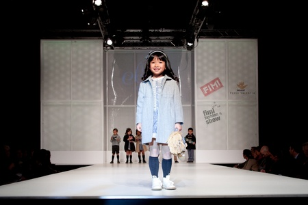 VALENCIA, SPAIN - JANUARY 21: Unknown child model at the FIMI Children's Winter Fashion Show with the designer Elisa Menuts on the runway in the Feria Valencia on January 21, 2011 in Valencia, Spain.