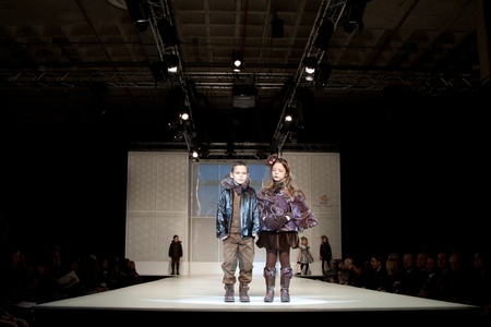 children's show: VALENCIA, SPAIN - JANUARY 21: Unknown child models at the FIMI Childrens Winter Fashion Show with the designer Lea Lelo on the runway in the Feria Valencia on January 21, 2011 in Valencia, Spain.