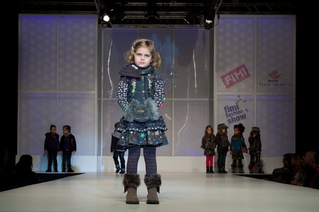 VALENCIA, SPAIN - JANUARY 21: An unidentified child model at the FIMI Childrens Winter Fashion Show with the designer Paglie in the Feria Valencia on January 21, 2011 in Valencia, Spain.