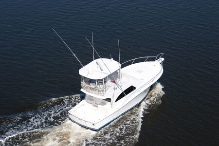 White luxury Fishing Boat from overhead in the sea photo