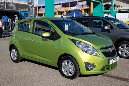mpg: VALENCIA, SPAIN - SEPT 3: A 2011 Chevrolet Spark on display at the FIA World Touring Car Championship on September 3, 2011 in Valencia, Spain.  The Spark is a compact car sold in Europe with a top speed of 102 mph and gets 46 mpg. Editorial