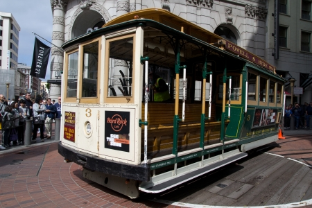 streetlife: SAN FRANCISCO - AUG 20: A cable car is turning around at the end of its line on August 20, 2011 in San Francisco.  It is the oldest mechanical public transport in San Francisco which is in service since 1873.