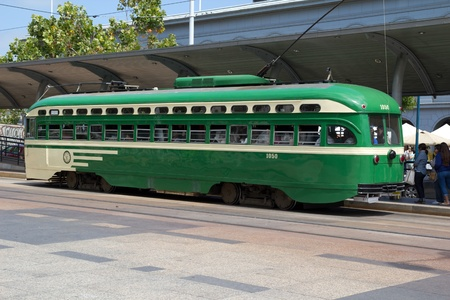 """renovated: SAN FRANCISCO - AUG 20: A historic streetcar picking up passengers on August 20, 2011 in San Francisco. This 1950s """"1050-class"""" Muni Streetcar was fully renovated in 1995."""