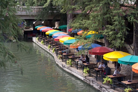 SAN ANTONIO, TX - AUG 12: The San Antonio River Walk in San Antonio, Texas on August 12, 2011.  The River Walk is 5 miles long on the banks of the San Antonio River. Over 20 events take place on the River Walk every year. Stock Photo - 10559393