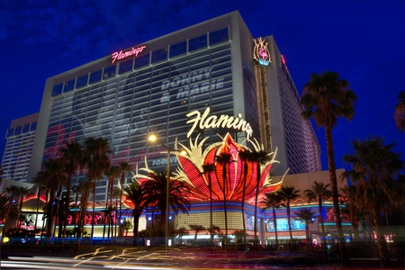 sq: LAS VEGAS - AUG 18: The Flamingo Hotel on August 18, 2011 in Las Vegas. The Flamingo, the oldest on the Strip, offers a 77,000 sq ft (7,200 m2) casino along with 3,626 hotel rooms.