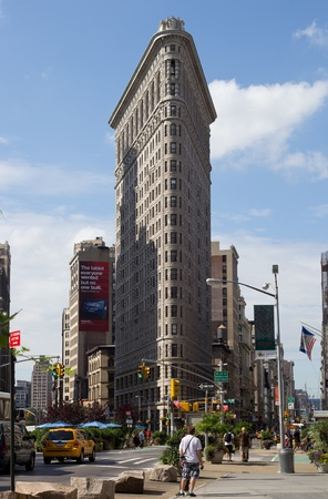 NEW YORK CITY - AUG 4: The Flat Iron building on August 4, 2011 in Manhattan, New York City. Completed in 1902, it is considered to be one of the first skyscrapers ever built. Stock Photo - 10753212