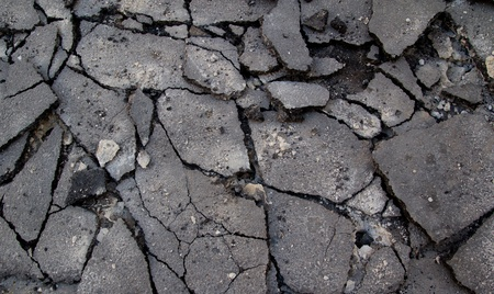 ruined: Broken Asphalt in the Street