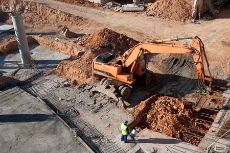 construction vehicle: Construction site with excavating equipment