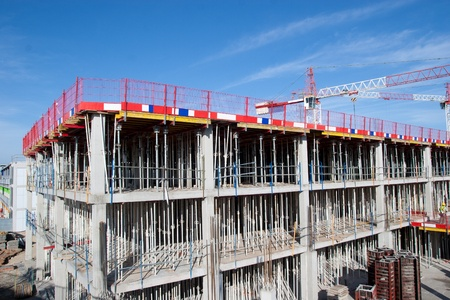 property development: Construction Site with Crane and Scaffolding Stock Photo