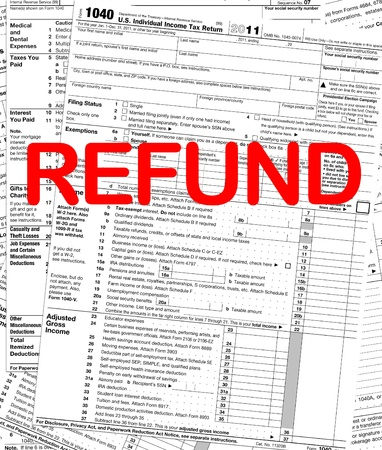 figuring: U.S. Individual Income Tax Return Refund Stock Photo