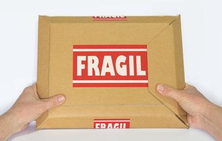 Cardboard Box Marked Fragile Banco de Imagens